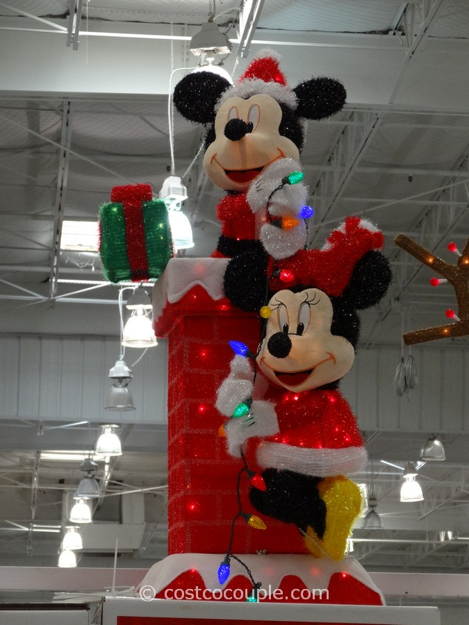 mickey and minnie decorating the chimney costco 5